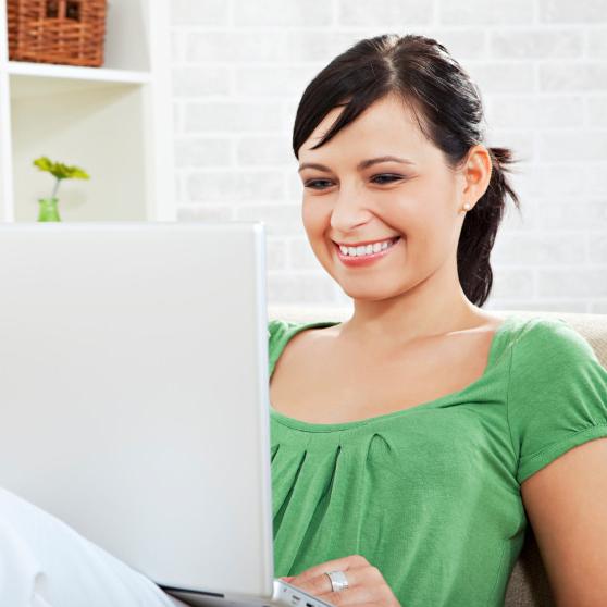 Happy Women Using Laptop