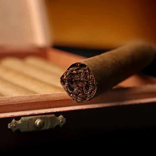 Cigar On Top Of Cigar Box